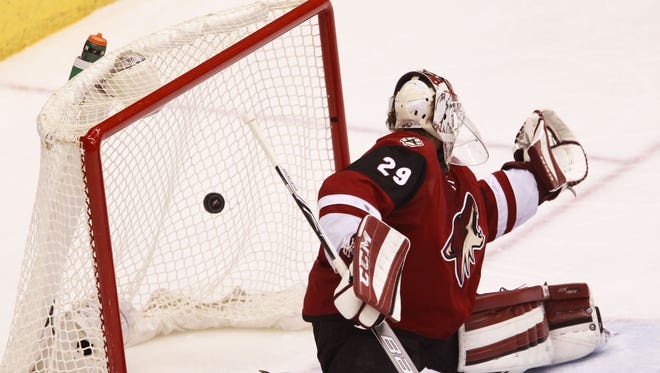 A goal slips past Arizona Coyotes' goalie Anders Lindback as the Arizona Coyotes face off against the Los Angeles Kings on Tuesday, Feb. 2, 2016, at Gila River Arena in Glendale, Ariz. Kings beat the Coyotes 6-2.