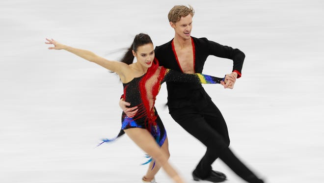 Madison Chock and Evan Bates of the US  compete in the Ice Dance Short Dance of the Figure Skating competition at the Gangneung Ice Arena during the PyeongChang 2018 Olympic Games, South Korea, Feb. 19, 2018.