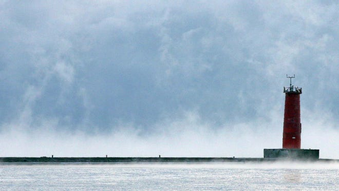With temperatures in single digits, steam caused by the warmer Lake Michigan water makes for a frigid lakefront Thursday January 5, 2017 in Sheboygan.