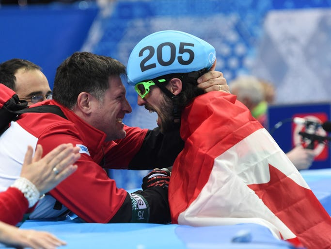 Feb 10, 2014; Sochi, RUSSIA; Charles Hamelin (CAN) (205) celebrates after winning the gold medal the mens 1500m short track speed skating finals during the Sochi 2014 Olympic Winter Games at Iceberg Skating Palace. Mandatory Credit: Robert Deutsch-USA TODAY Sports