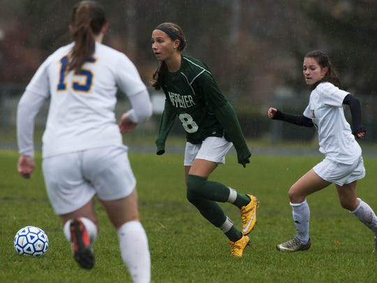 Montpelier's Callie-Lyn Dalley (8) runs down the field