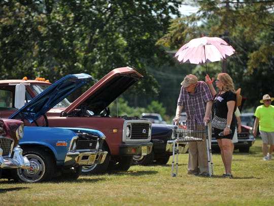 New Jersey Veterans Memorial Home resident Melvin Lyman tells volunteer Carol Farrell about some of the antique cars they pass during the Salute to Our Veterans Car Cruise there, Aug. 28, 2016 in Vineland.