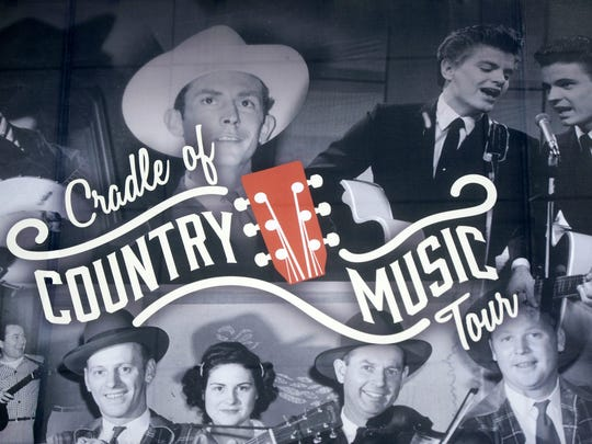 Hank Williams, The Everly Brothers and other artists are pictured on a banner featuring musicians on the Cradle of Country Music Walking Tour. The banner hangs on the side of the Dwight Kessel Garage, at 900 State St.