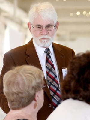 Chuck Bennett, the current Ward 1 city councilor, speaks to people before his Salem mayoral candidate debate at the Willamette Heritage Center in Salem on Friday, April 8, 2016.