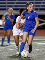 Horseheads' Sarah Wagner looks to pass the ball during