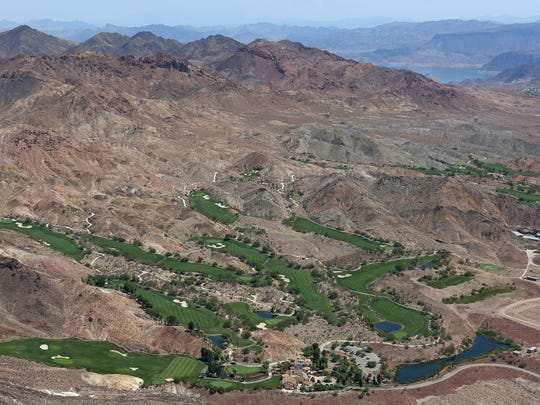 The swaths of green at Lake Las Vegas stand out amid the desert hills in Henderson, Nevada.