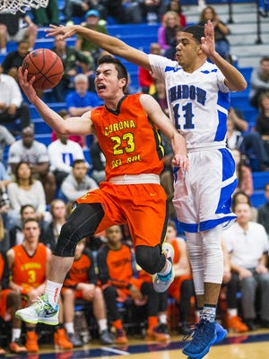 Corona del Sol's Alex Barcello, left, goes up for a basket as Shadow Mountain High School's Jordan Pace defends during game against Corona del Sol at Shadow Mountain High School, Monday, January 18, 2016.