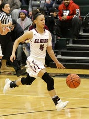 Elmira's Kiara Fisher drives to the hoop against Elmira