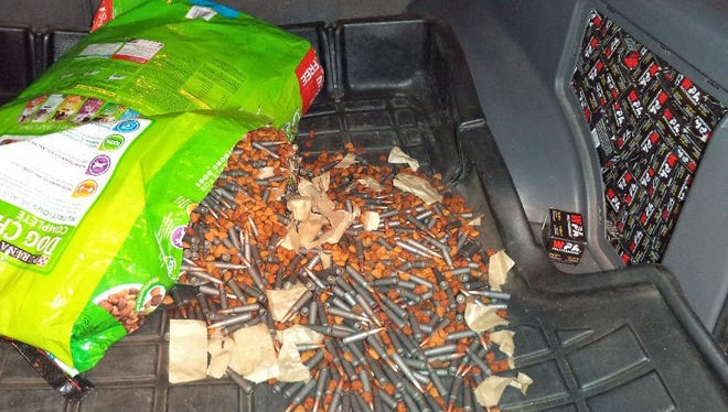 Bullets and Dog food spill into the back cargo space while boxes of ammunition is stacked tight inside the back panel.