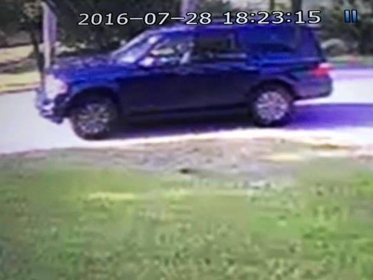 The suspects' vehicle: A blue Ford Expedition SUV.