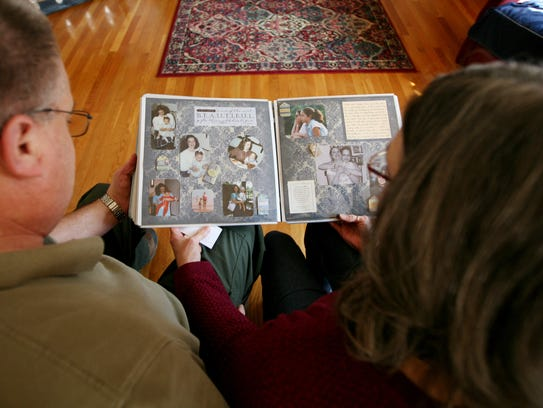 David and Nancy Jo Gibson of Waynesboro hold a scrapbook