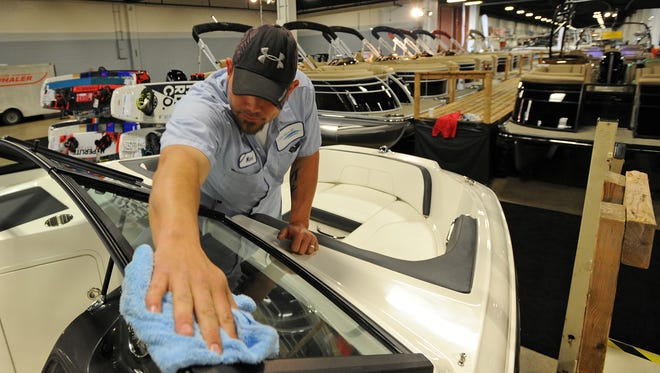 Adam Smith shines the windshield of a boat in the Sea Ray of Greenville booth while setting up for the 46th Annual Upstate SC Boat Show at the TD Convention Center on Wednesday, January 27, 2016. The show will run from Thursday, January 28 through Sunday, January 31.