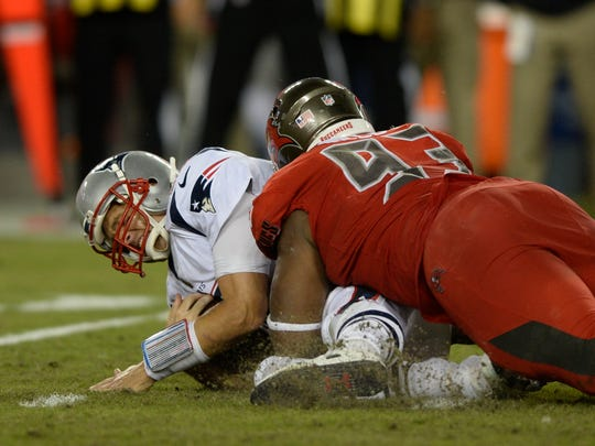 New England Patriots quarterback Tom Brady, left, is sacked by Tampa Bay Buccaneers defensive tackle Gerald McCoy during the first half of an NFL football game, Thursday, Oct. 5, 2017, in Tampa, Fla. (AP Photo/Jason Behnken)