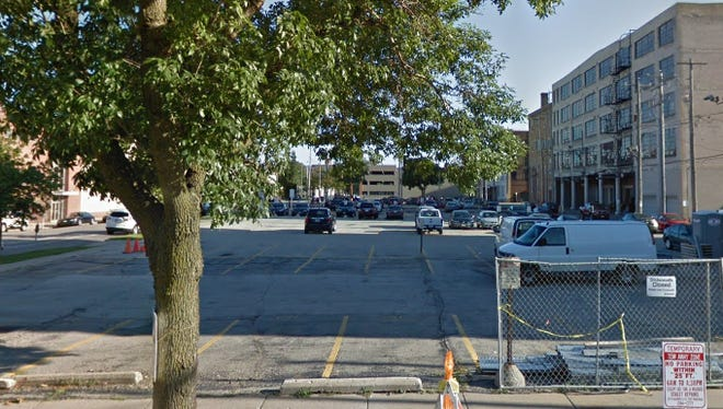 A large apartment building is being proposed for this Historic Third Ward parking lot south of East St. Paul Avenue and west of North Jefferson Street.