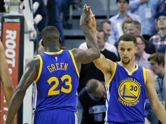 Draymond Green high-fives Stephen Curry in the second