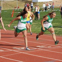 Virgin Valley's Abbie Barnum, right, edges teammate Kaydee Bingham at the finish line of the girls' 100-meter race earlier this season. Both VVHS tracksters placed at state last weekend in Carson City.
