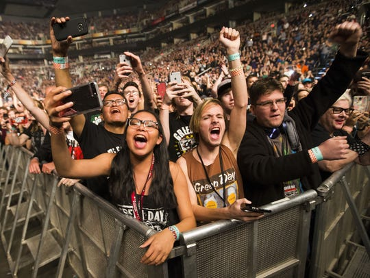 Fans wait for Green Day to take the stage for their