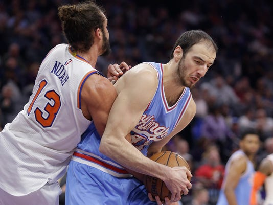 Sacramento Kings center Kosta Koufos, right, pulls a rebound away from New York Knicks center Joakim Noah during the second quarter of an NBA basketball game Friday, Dec. 9, 2016, in Sacramento, Calif.(AP Photo/Rich Pedroncelli)