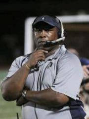 Former Chambersburg football coach Mark Saunders coaches in a win against Greencastle in this file photo.
