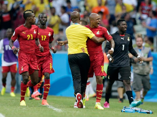 Ghana's Andre Ayew, right, celebrates after scoring his side's first goal during the group G World Cup soccer match between Germany and Ghana at the Arena Castelao in Fortaleza, Brazil, Saturday, June 21, 2014.  (AP Photo/Matthias Schrader)