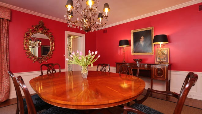 "Victoria Klein, who decorated the house, ""nailed it with this red in the dining room because red can be such a tough color,"" says listing agent Arthur Scinta."