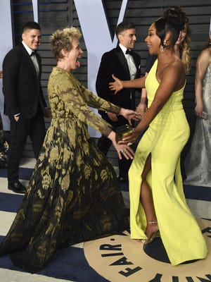 Frances McDormand, left, and Tiffany Haddish greet each other at the Vanity Fair Oscar Party on Sunday, March 4, 2018, in Beverly Hills, Calif. (Photo by Evan Agostini/Invision/AP)