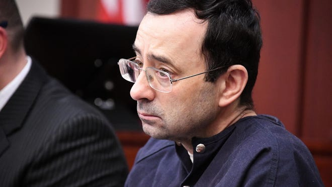 Larry Nassar listens to the testimony of Isabel Hutchins in the courtroom of Judge Rosemarie Aquilina on Tuesday.
