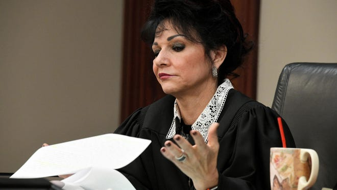 Judge Rosemarie Aquilina tosses aside a letter defendant Larry Nassar wrote, in which he accused her of seeking the spotlight during his trial.