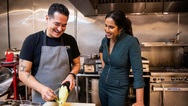 "Emiliano Marentes, left, owner of Elemi, appears in his kitchen as host Padma Lakshmi looks on, in a scene from ""Taste the Nation,"" a documentary series streaming on Hulu."