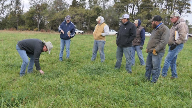Dusty Tachas, NRCS area officer for more than 25 counties in Kansas, speaks to farmers and ranchers about cover crops on pasture during the Cheney Lake Watershed's Field Day on Oct. 23 at Blew's land in Reno County, Kans.