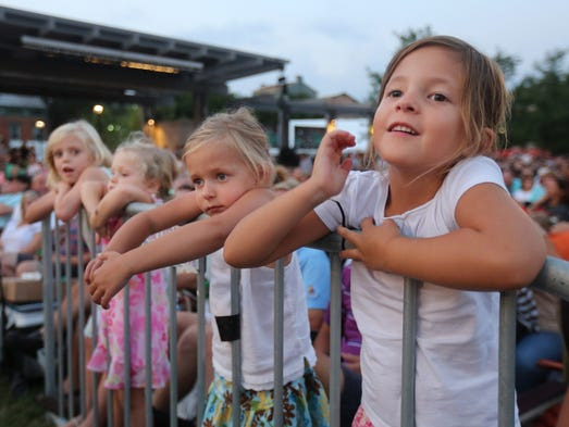From left to right: Lyla Rybolt, 6, from Mt. Lookout, Lauren Rybolt, 4, Ella Tinsler, 5, from Madeira, and Ava Tinsler, 5, watch Lumenocity at Washington Park on Saturday, August 2, 2014.