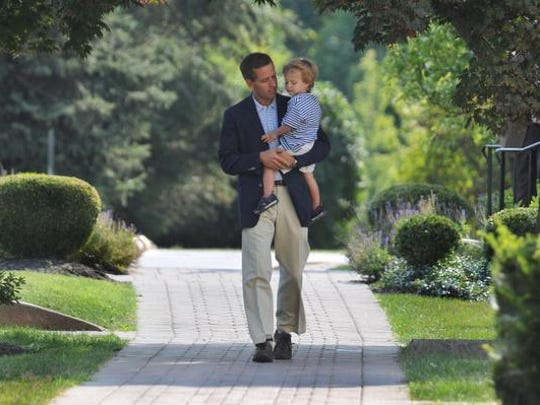 Beau Biden and son Hunter, 2, walk outside St. Joseph's