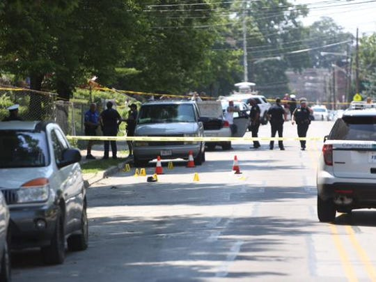 Police investigate the crime scene on Hewitt Avenue in Evanston after a shooting occurred Wednesday afternoon. At least one person was injured.
