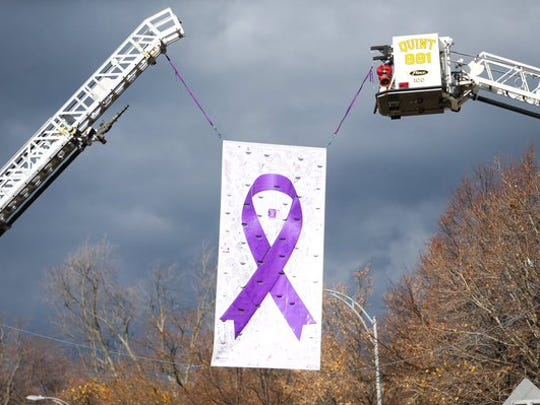 Canandaigua fire trucks hang a banner for Courtney Wagner as mourners gather for her funeral on Nov. 7