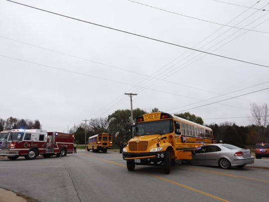A car and school bus in an accident near Farm Road