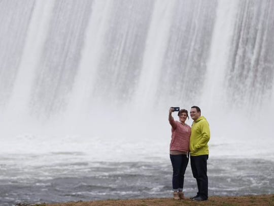 Two people take a selfie in front of the Table Rock