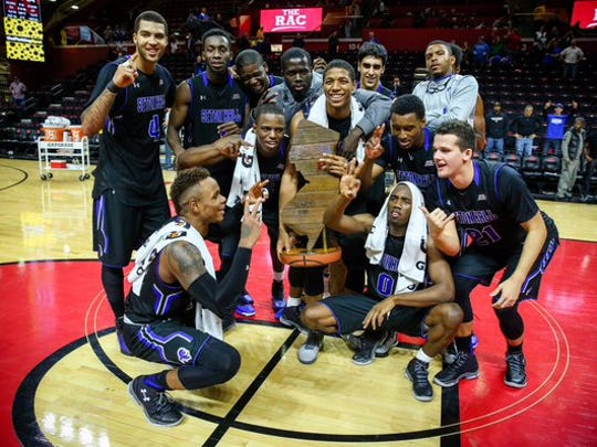 Seton Hall's players pose with the Boardwalk Trophy last December.
