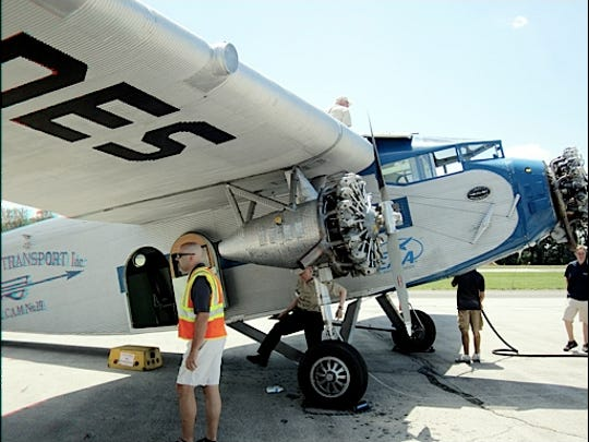 Close-up of 1929 Ford Tri-Motor Airplane while refueling between flights at New