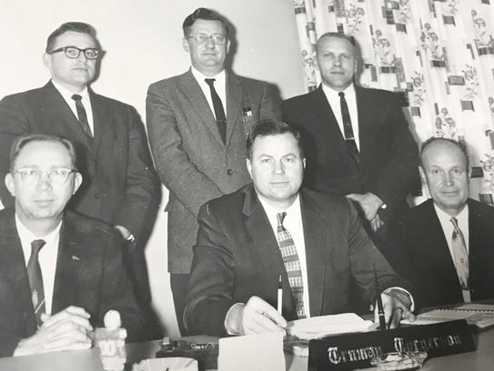 Truman Torgerson (front center) helped area farmers