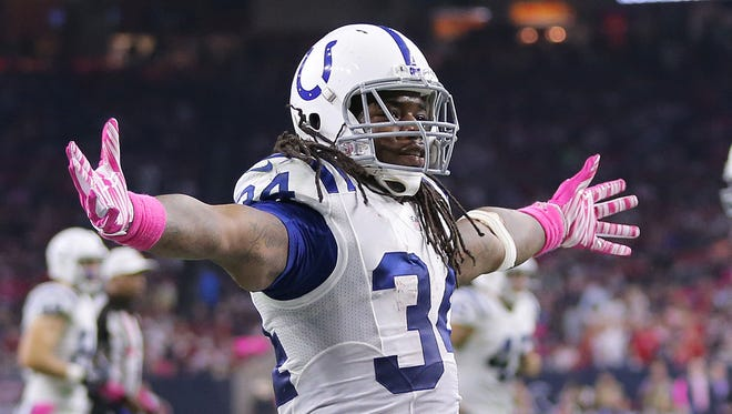 Indianapolis Colts Trent Richardson celebrates scoring his first touchdown against the Texans in the first quarter. Indianapolis traveled to Houston for a Thursday night game October 9, 2014.