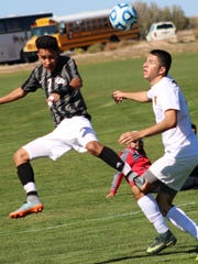 Alamogordo's Julian Torres, right, battles Chaparral's Juan Torres for possession Thursday afternoon.