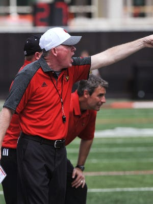 Louisville head coach Bobby Petrino yells instructions at his team during the UofL Spring Game on Saturday at Papa John's Cardinal Stadium. April 15, 2017