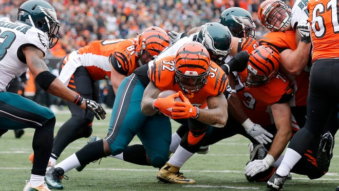 Cincinnati Bengals running back Jeremy Hill (32) dives over the goal line for a touchdown in the first quarter of the NFL Week 13 game between the Cincinnati Bengals and the Philadelphia Eagles at Paul Brown Stadium in downtown Cincinnati on Sunday, Dec. 4, 2016.