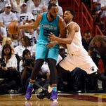 Apr 20, 2016; Miami, FL, USA; Charlotte Hornets center Al Jefferson (25) dribbles the ball as Miami Heat center Hassan Whiteside (21) defends in game two of the first round of the NBA Playoffs during the second quarter at American Airlines Arena. Mandatory Credit: Steve Mitchell-USA TODAY Sports