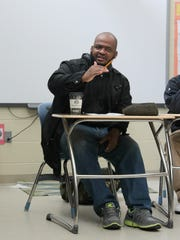 Jackson native Kiese Laymon visits with students in the classroom.