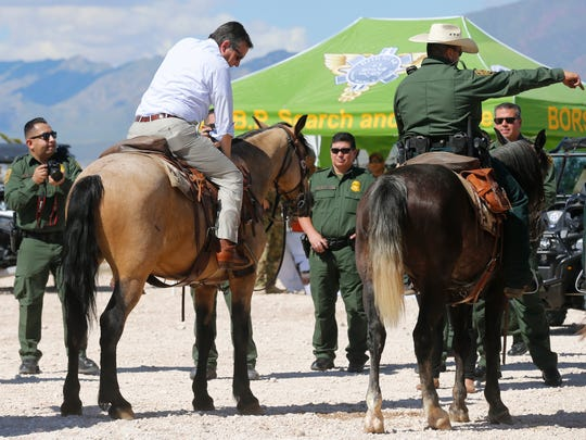 U.S. Sen. Ted Cruz, R-Texas, rides a Border Patrol horse along the U.S.-Mexico border during his visit to the El Paso area on Thursday.