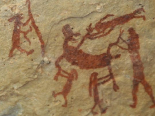 A rock art scene depicting a kill.