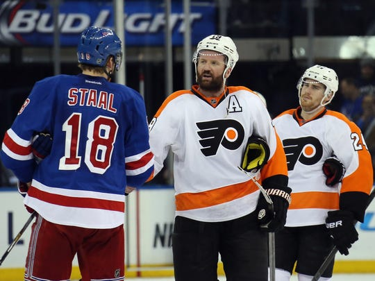 Marc Staal shakes hands with Scott Hartnell of the Philadelphia Flyers.