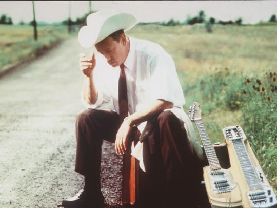 """The only person you'll see playing the """"guit-steel"""" at the 2016 jazz fest is roadhouse country artist Junior Brown. It's an instrument of his own invention."""