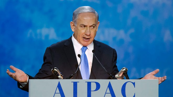 Israeli Prime Minister Benjamin Netanyahu gestures while addressing the 2015 American Israel Public Affairs Committee (AIPAC) Policy Conference in Washington, Monday, March 2, 2015.